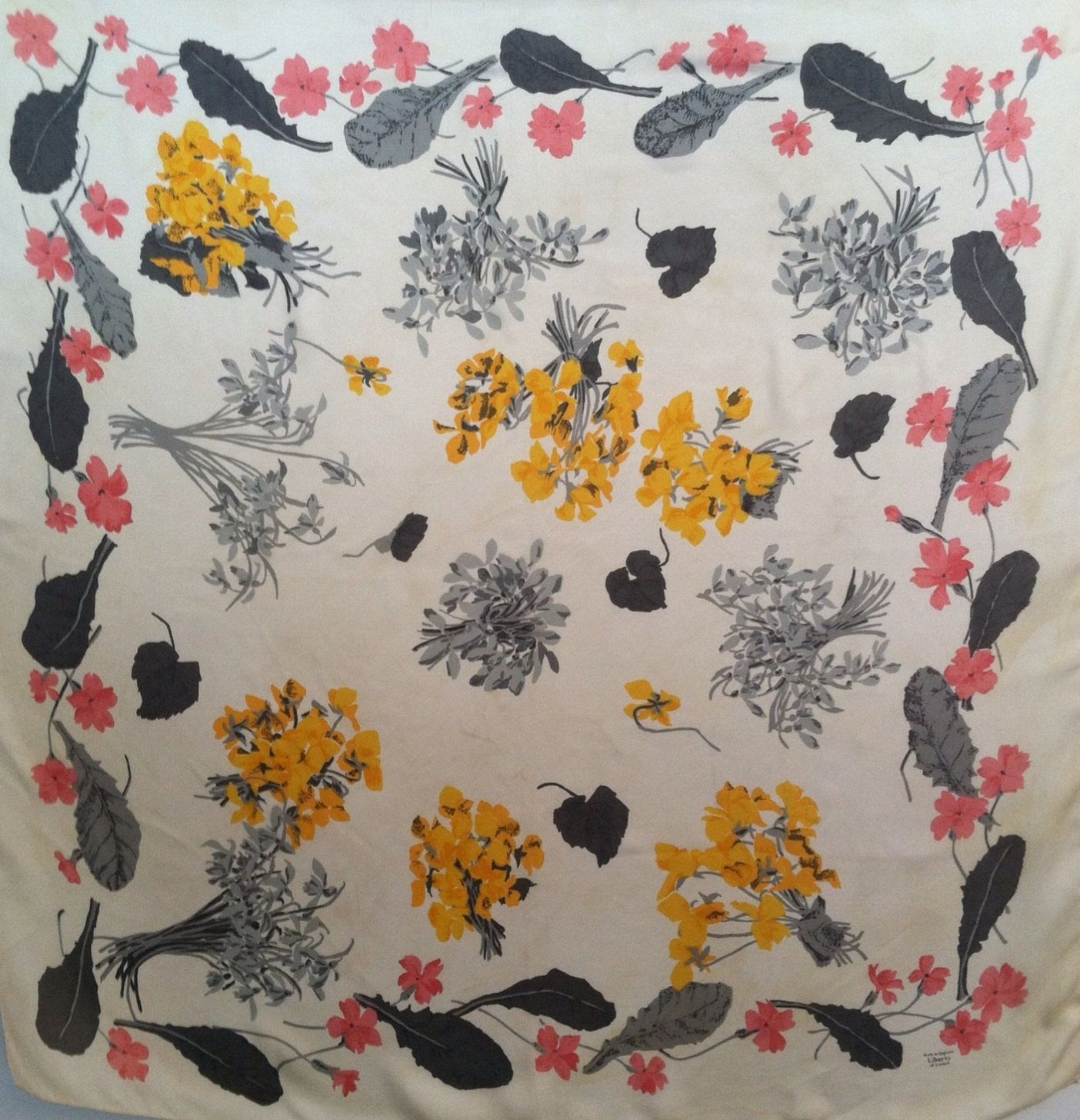 Vintage c.1960s Liberty of London floral and ivory silk scarf. $35.50, via Etsy.
