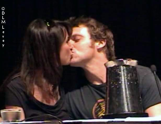 Happily married husband and wife: Michael Shanks and Lexa Doig sharing their kisses