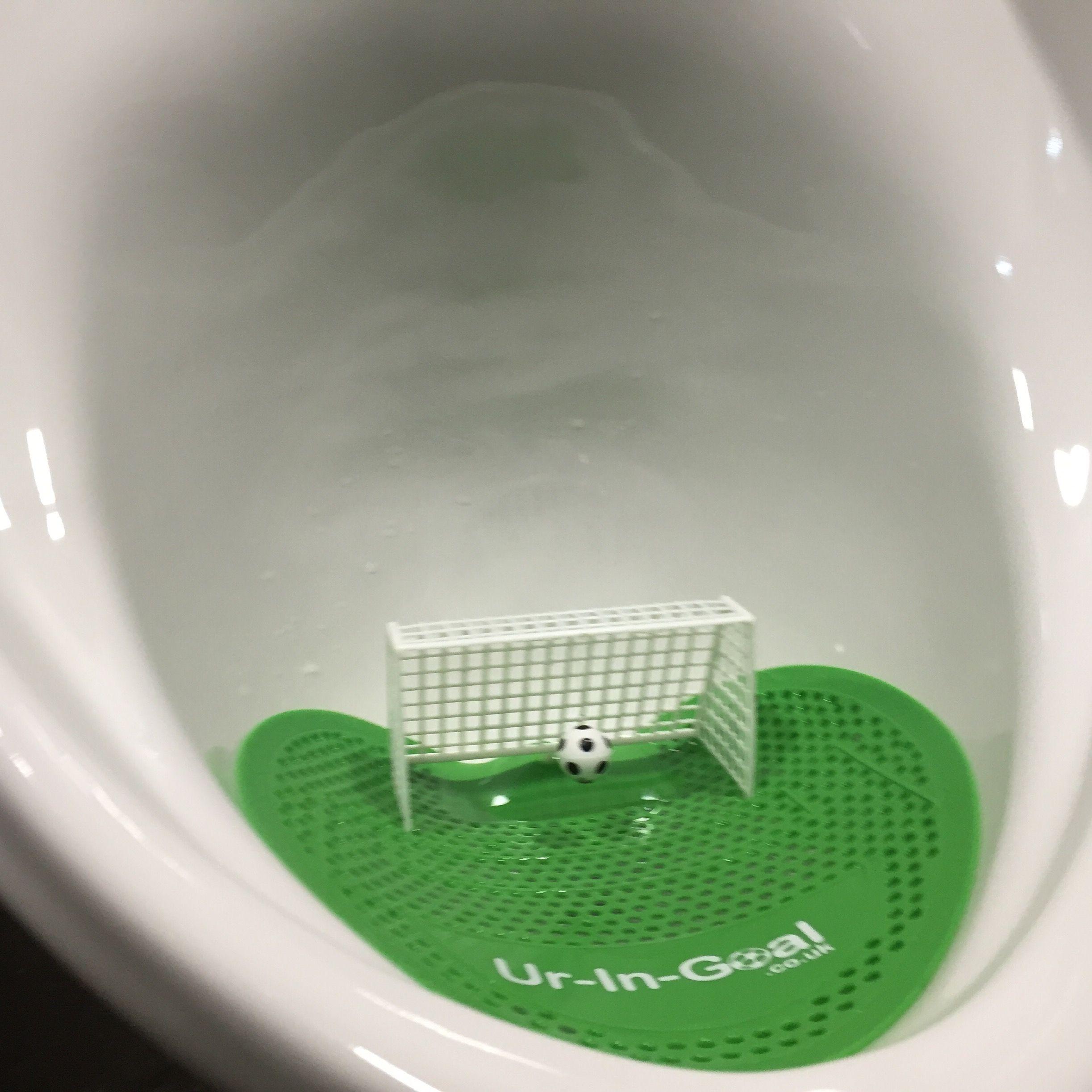 Close Up Photo Of Urinal Mat Goal Cake Soccer