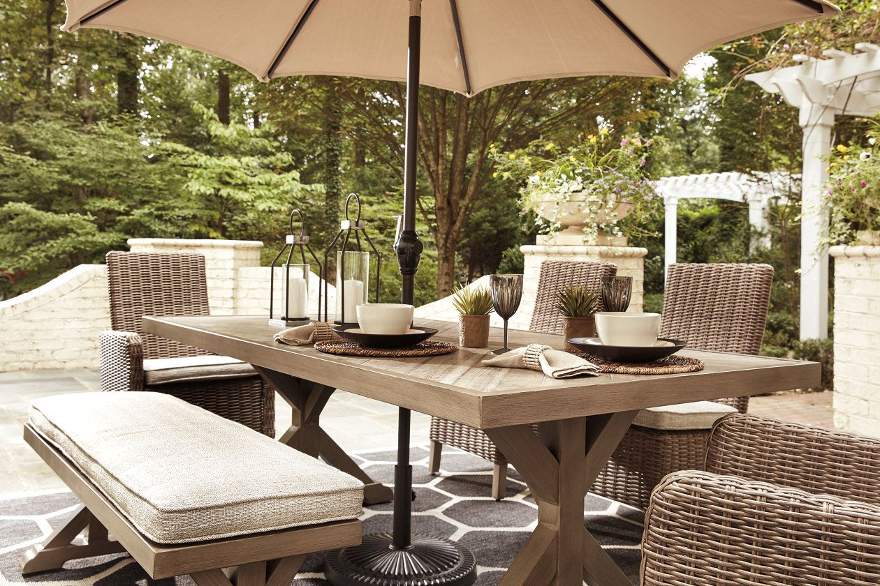 Beachcroft Dining Table With Umbrella Option Ashley Furniture Homestore Outdoor Dining Table Outdoor Dining Set Dining Table