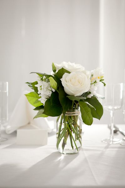 Simple glass or mason jars can work even outside of the for Mason jar flower arrangement ideas