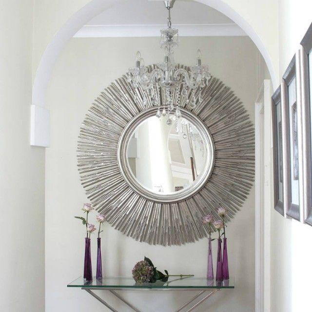 silver sunburst mirror, metal & glass console table, aubergine glass vases