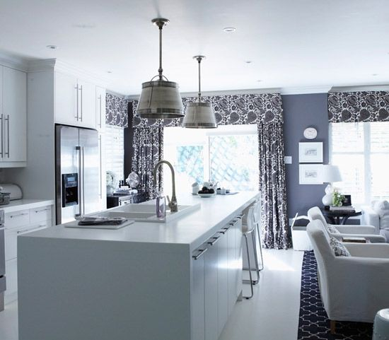white and gray kitchen with sliding glass door and bucket fixtures