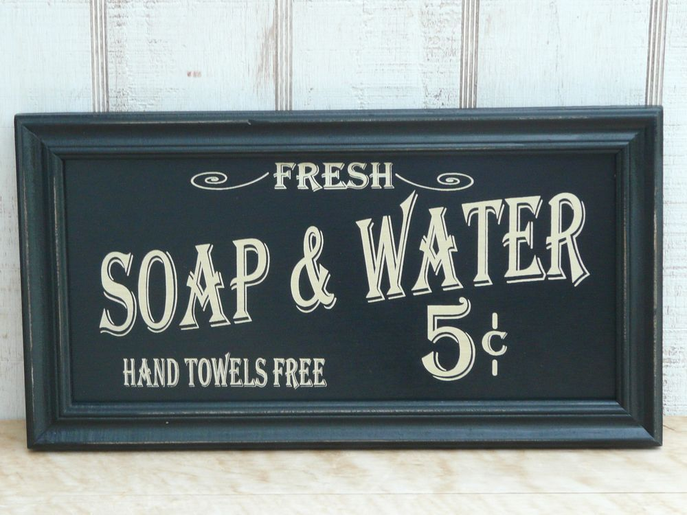 The Vintage Soap Water Sign Adds Clic Charm To Bath Or Kitchen Black Wood Panel Set In A Distressed Frame And Old Fashioned Script On