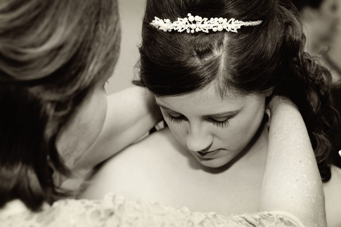 A mother helping her daughter put on her necklace on her wedding day. Shea McGrath Photography www.sheamcgrath.com