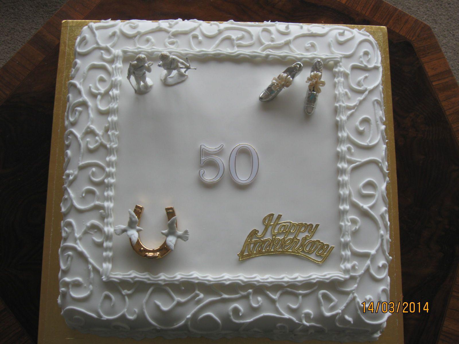 Th wedding anniversary cake using some decrations off the original