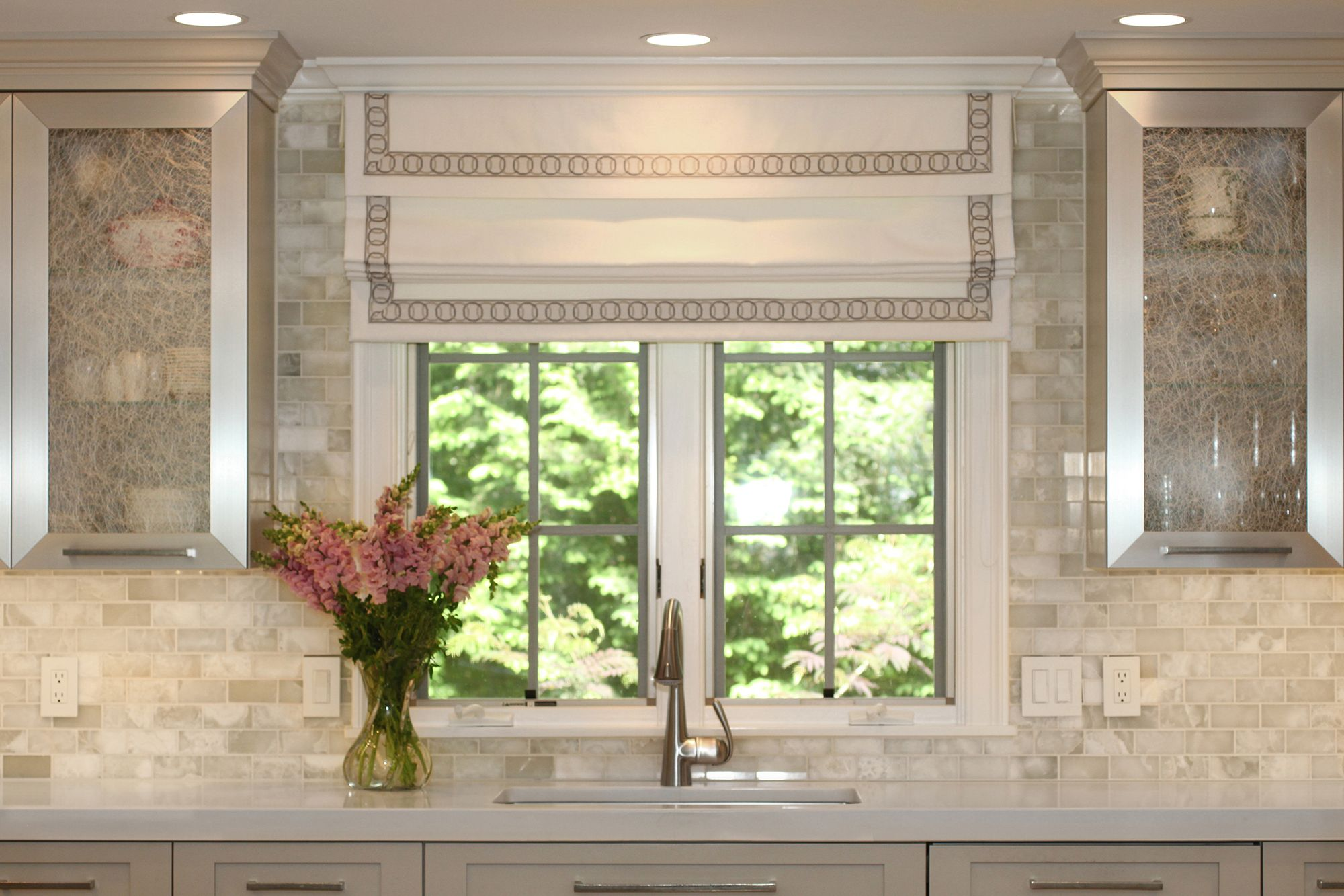 Luxurious details in this family room kitchen renovation include a luxurious details in this family room kitchen renovation include a white onyx subway tile backsplash dailygadgetfo Images