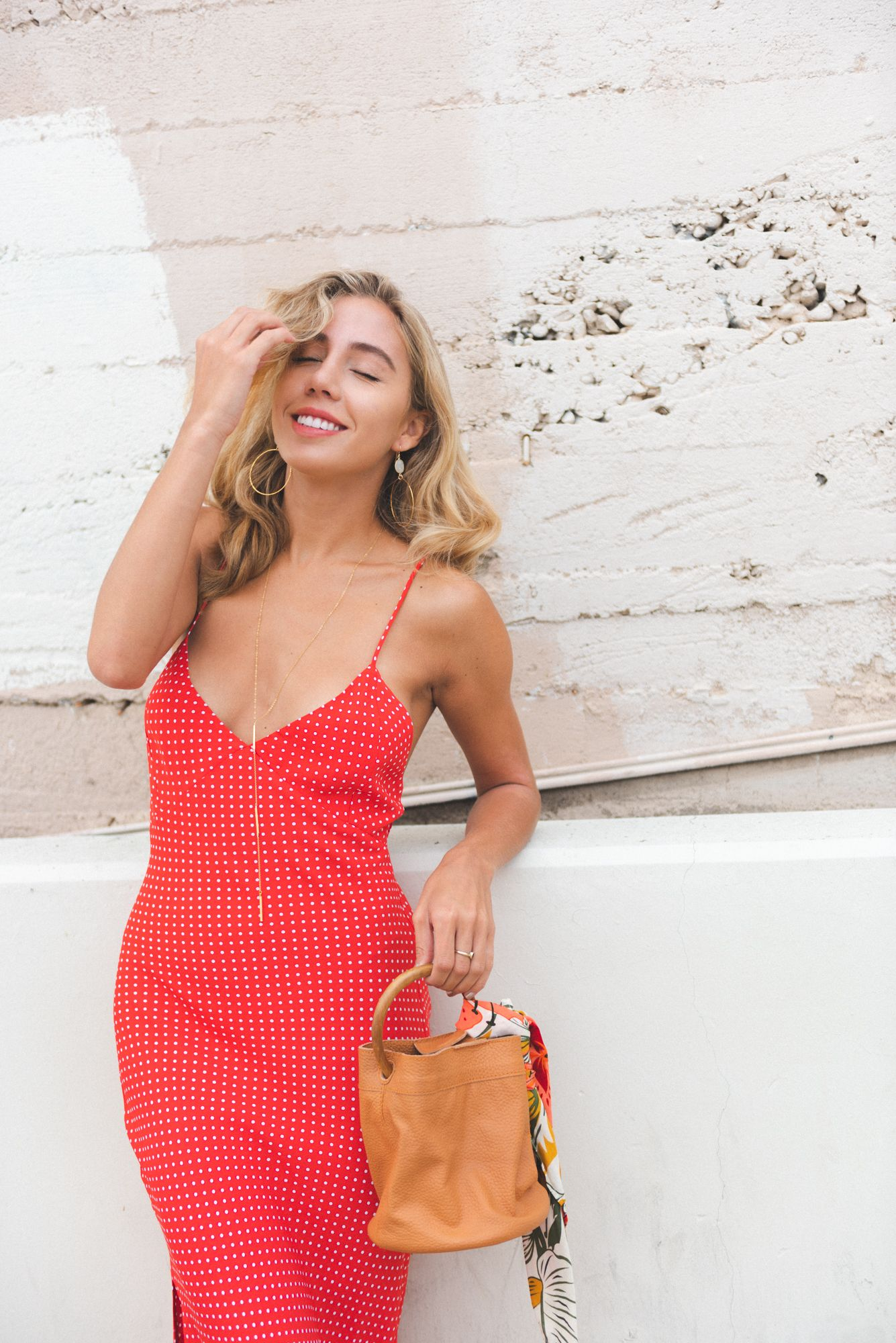 bbb34205619e9 Summer Wardrobe You Need include a slinky midi slip dress. Polka Dot slip  dress blue life slip dress midi dress layered jewelry top shop red slides  Red ...