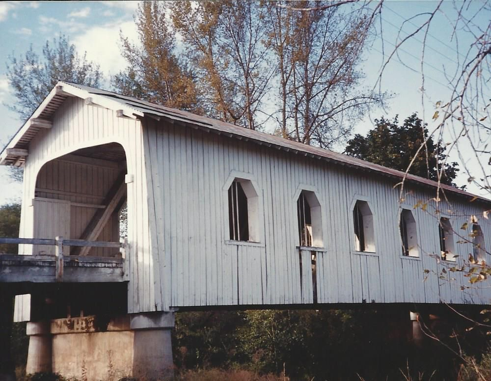 this is the covered bridge i saw in Sunny Valley, OR 1993.  a nice man took me over on his horse/buggy.  don't remember now how i got to talking to him -- or how he got to talking to me!