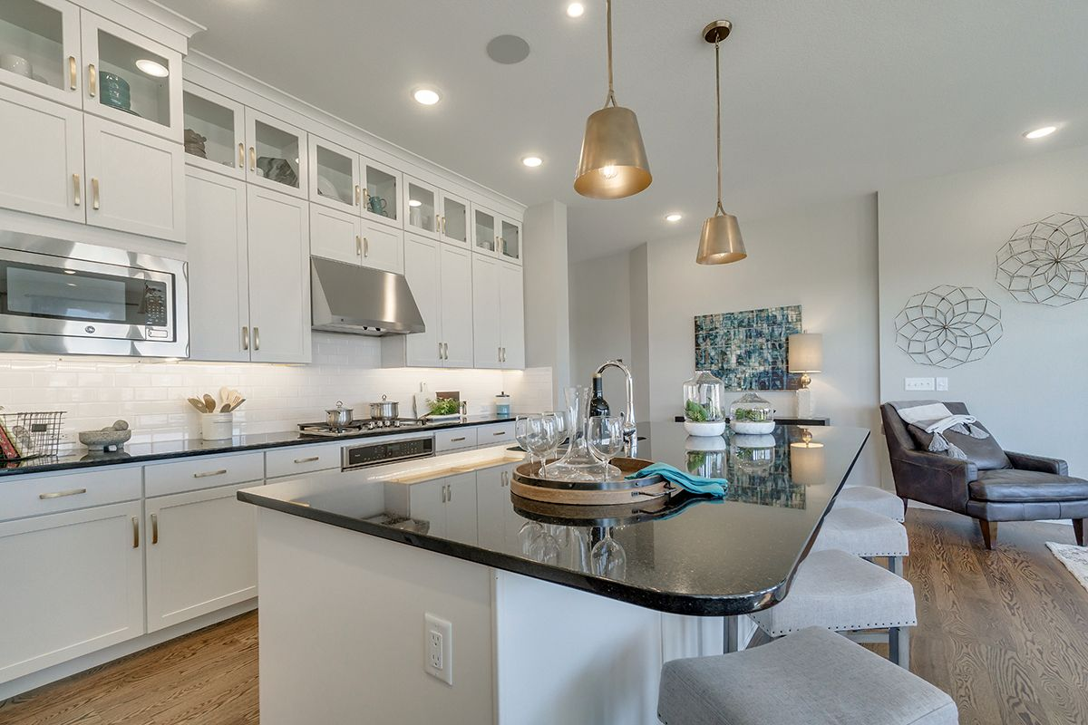 The Glisen Is Located In Colorado Springs Co This Kitchen Features Crisp Modern White Cabinets Picture Kitchen Utensils Store Kitchen Kitchen Inspirations