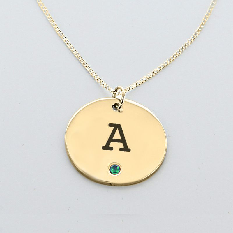 Engraved initial circle pendant with birthstone in yellow gold over engraved initial circle pendant with birthstone in yellow gold over silver aloadofball