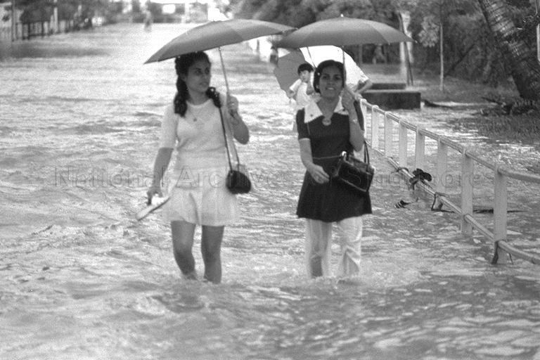 CAUGHT IN THE RAIN, THESE TWO GIRLS, ONE WITH SHOES IN