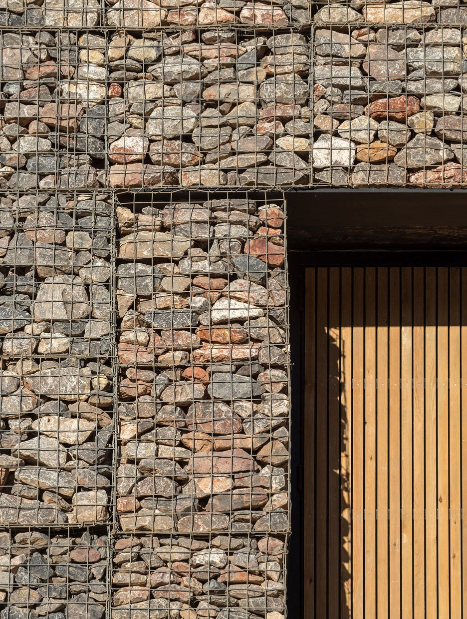 stone filled gabions help this police training centre camouflage stone filled gabions help this police training centre by architecture firm haverstock to camouflage the craggy walls of a former quarry in bristol