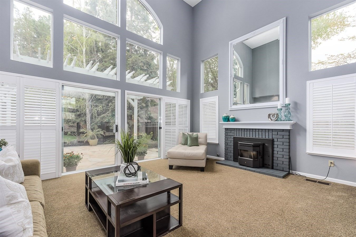 Zen Living Room With Fireplace And Patio Access Design