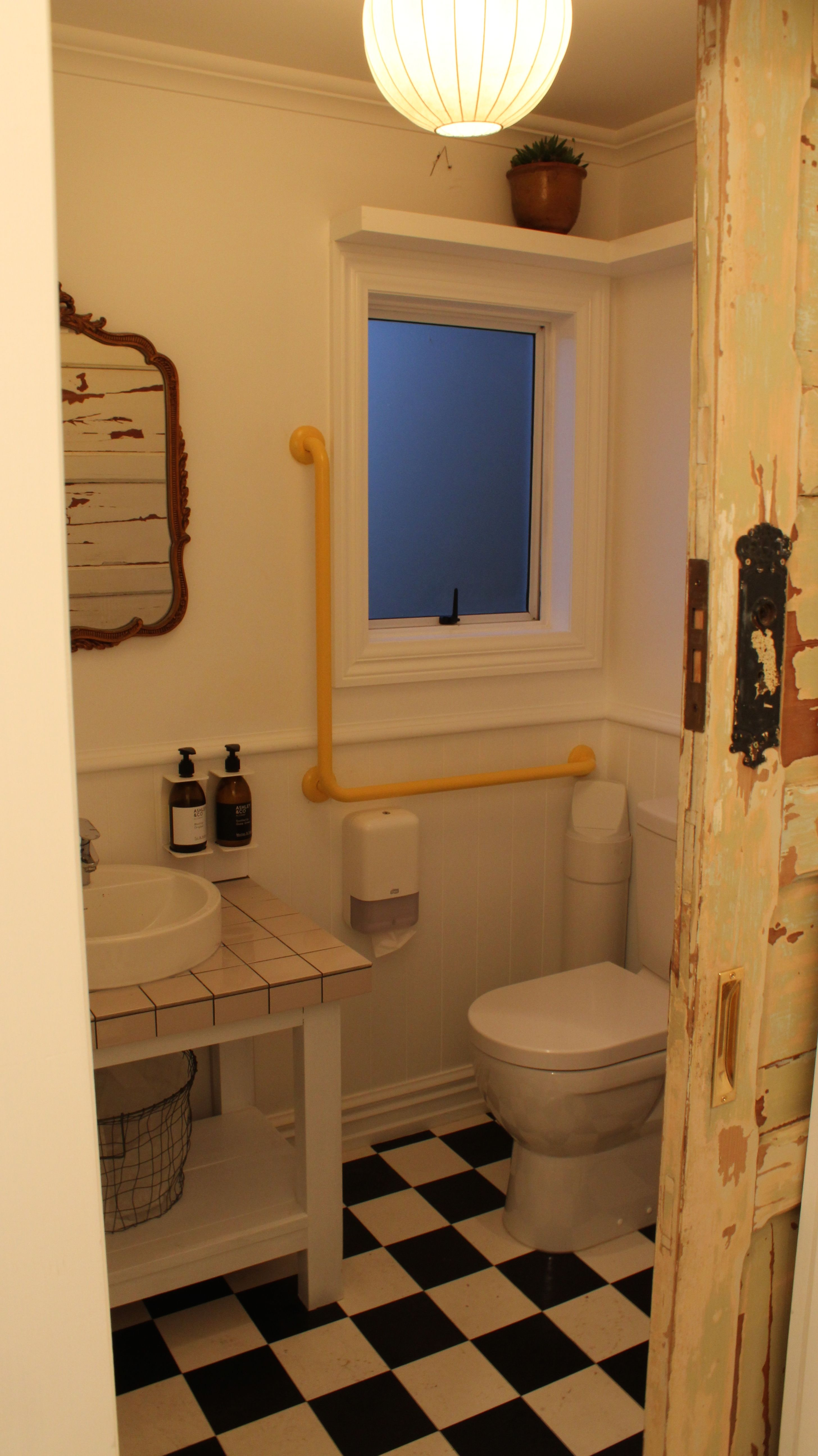 cafe fit out , bathroom , checkered floor , wainscoting