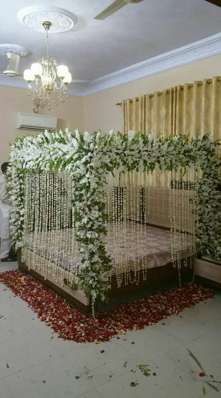 Pin by dacan fancy flower on wedding shadi bed sej masehri flower decoration service in karachi for Bedroom flower decoration images