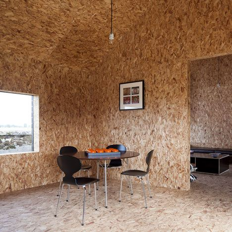 Oriented strand board lines every wall, floor and ceiling inside this residential barn extension in Norfolk, England, by London studio Carl Turner Architects.