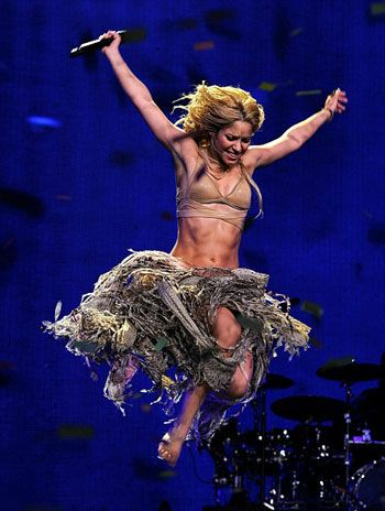 I chose this photo because it uses freeze motion and shadows to show Shakira  in her true performance mode. As a suggestion I think there ... 1b12b6551