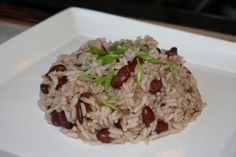 Classic island peas and rice. Ingredients: red kidney beans, black pepper, coconut milk, scotch bonnet pepper, onion, garlic, salt, thyme, rice, allspice, scallions, water. Recipe on Caribbean Pot.