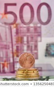 1 Euro cent against 500 Euro banknote coins and banknotes of the single European currency Money background