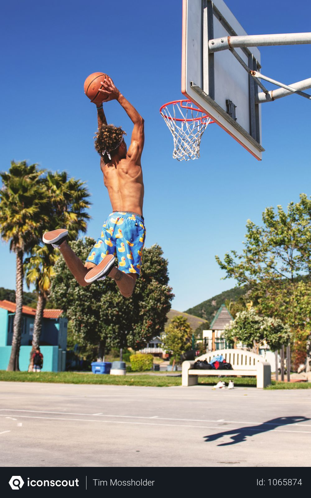 Free Man Wearing Blue And Yellow Shorts Playing Basketball