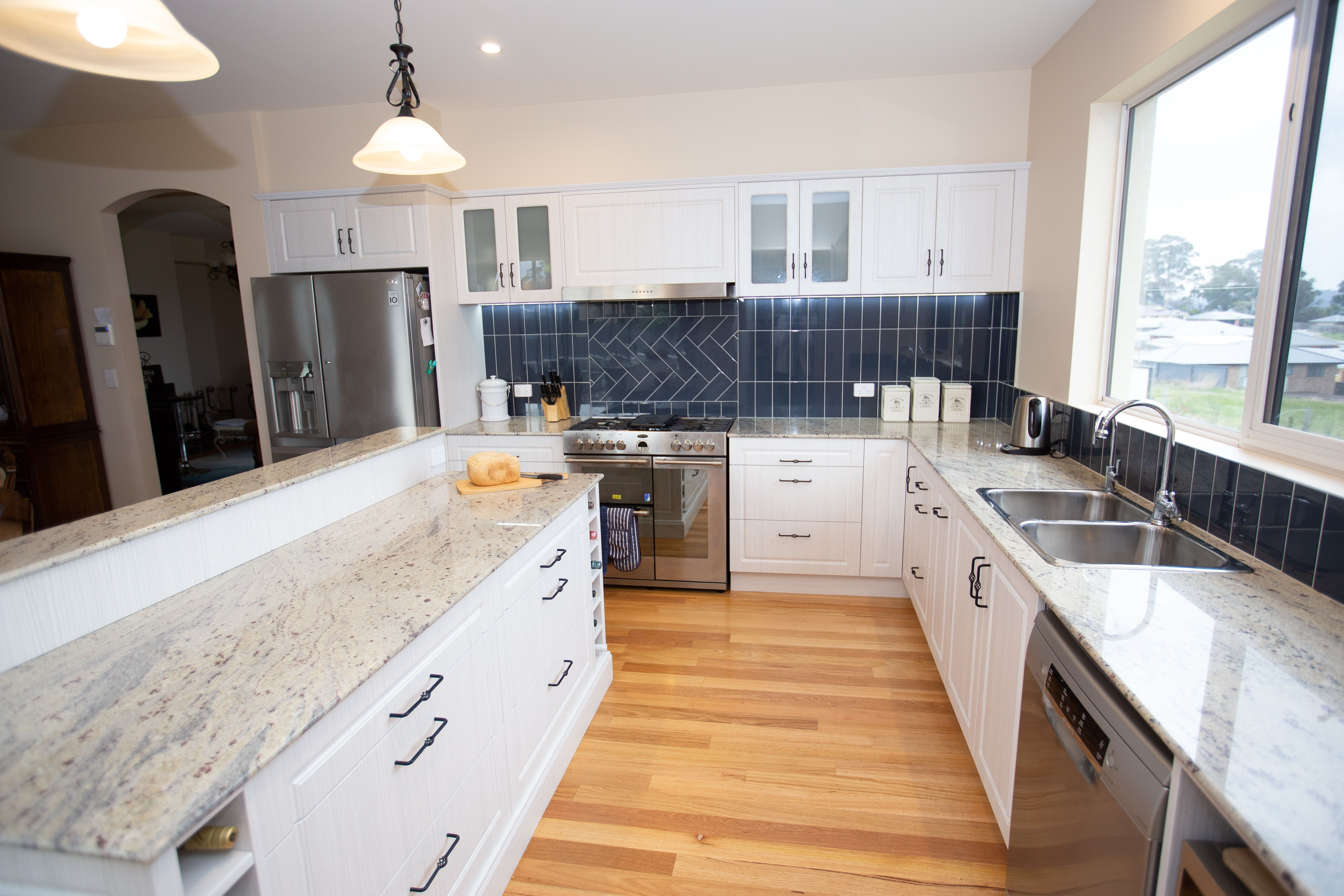 The White Cabinets Are All In The Colour Hacienda White Completed With Tesrol Vinyl Wrap Contemporary Kitchen Design Contemporary Kitchen Kitchen Design