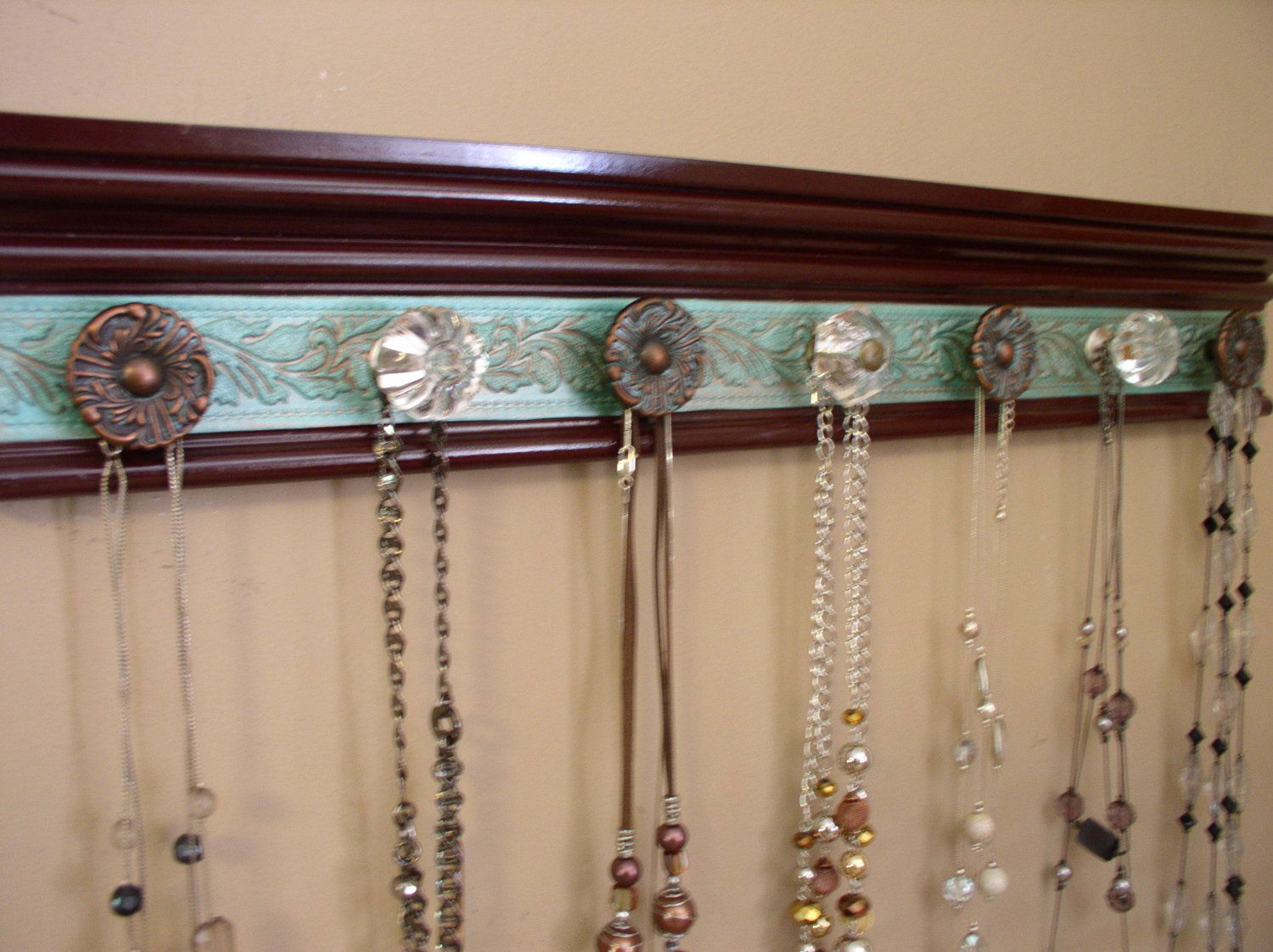 Use drawer pulls on wood trimmoldingpainted stenciled tole