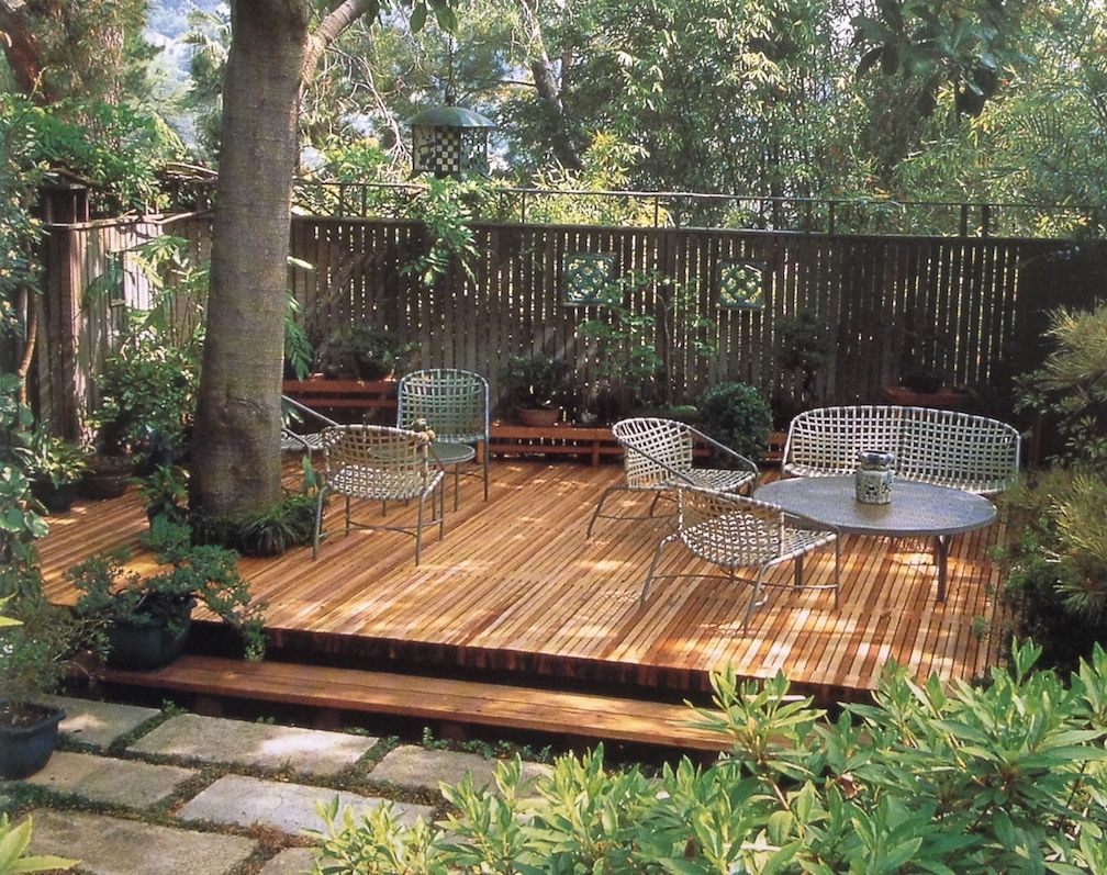 Shady deck around tree keith davitt beyond the lawn for Garden design decking areas
