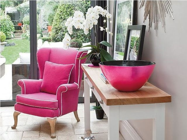Console table with large/medium photographs, orchid, and big magenta ...