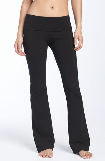 606f59c5c4a63 Form-fitting knit pants are styled with a wide, fold-over waistband, easily  adjusted for a high or low rise.