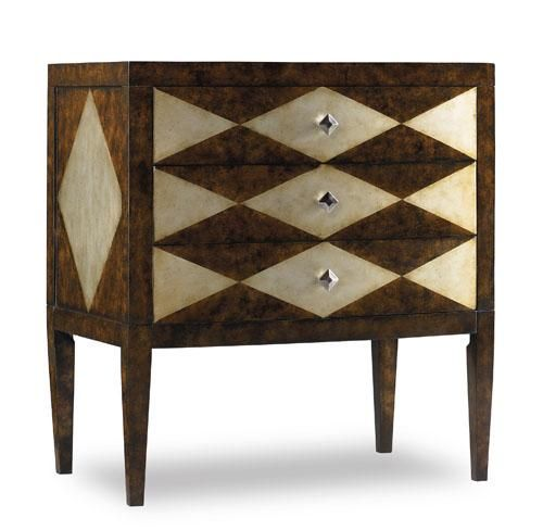 Diamond motif on top, sides, and drawer fronts.    Black and cream
