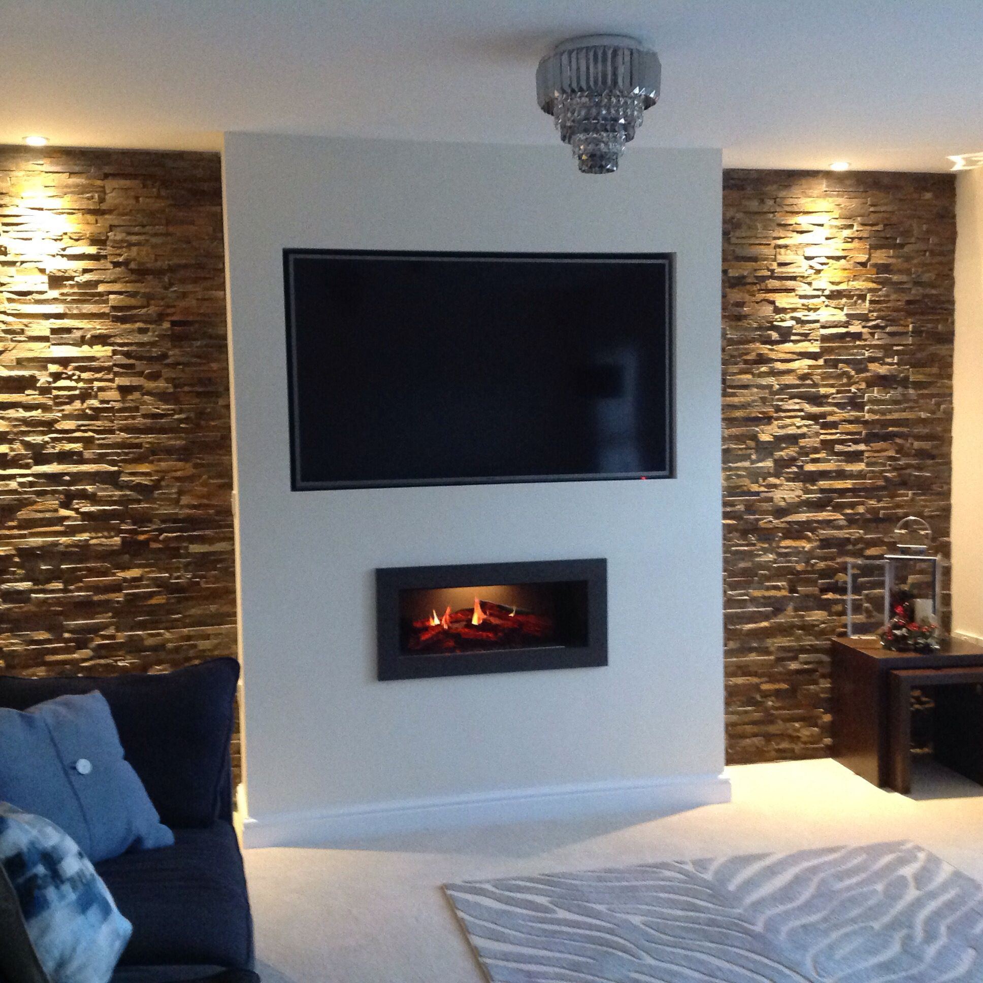 a false chimney breast, split slate in the alcoves with mood