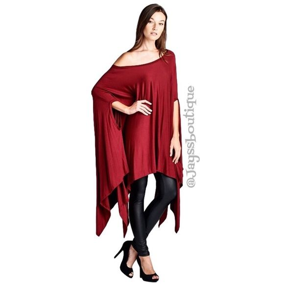 The CITY SCENE Poncho Tunic Red Ultra-soft and flowing, loose fit poncho tunic can be worn as a tunic top, cover-up or dress. Asymmetrical hemline. Edgy and sophisticated, yet comfy. Great as a beach cover-up too. 95% Rayon, 5% Spandex, made in USA. One Size Fits Most! Tops Tunics