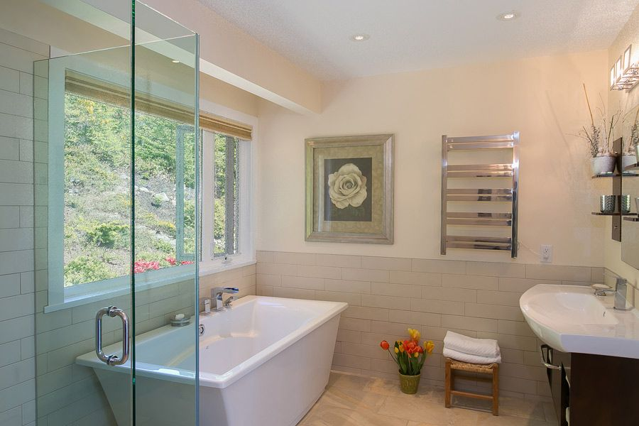 Modern Clean White Bathroom with stand alone bath tub in ...