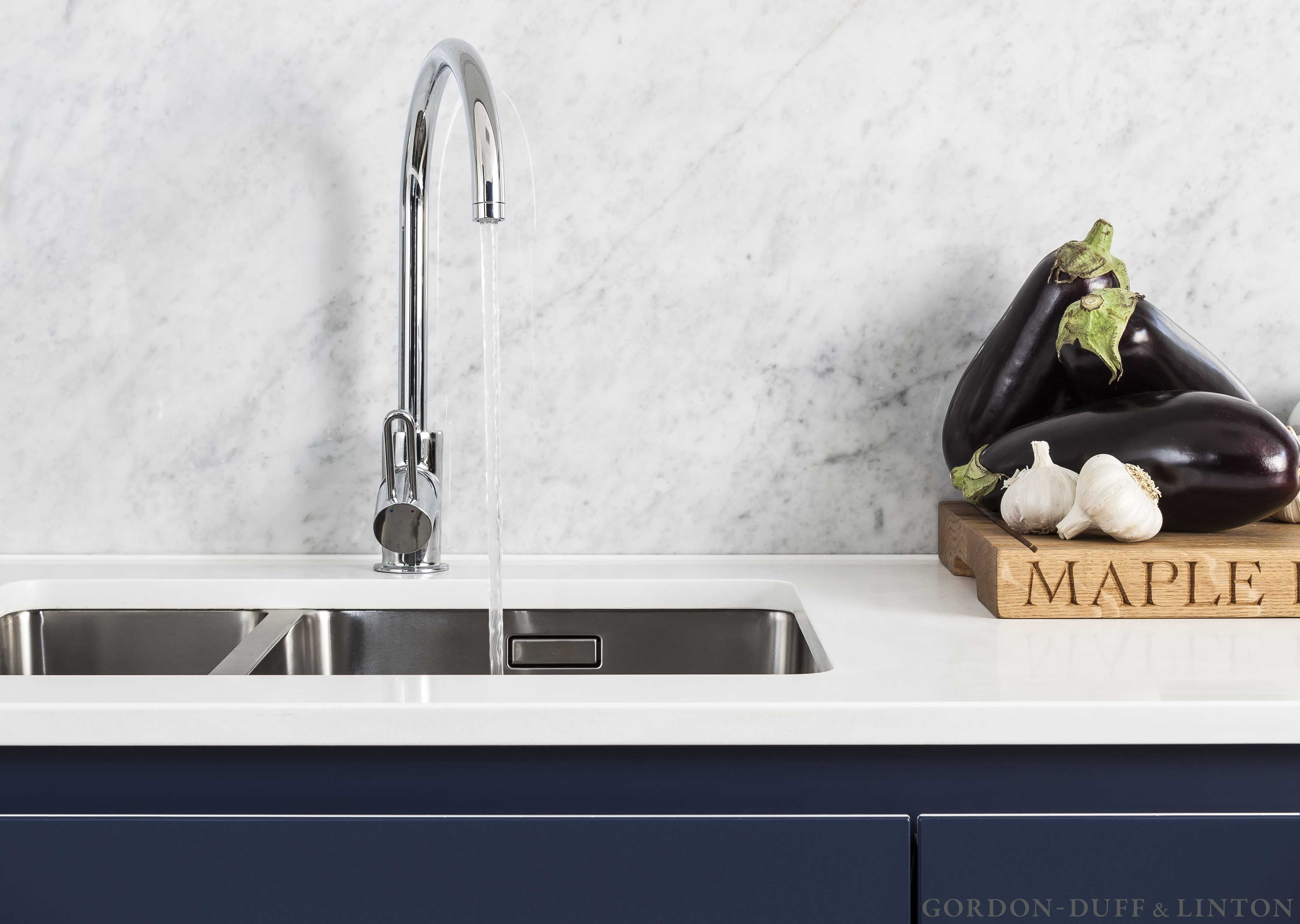 Kitchen detail of carrara marble splashback and Hansgrohe mixer tap ...