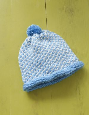 8010d9243f9 Knit this hat with the Martha Stewart Crafts Lion Brand Yarn Knit   Weave  Loom Kit.
