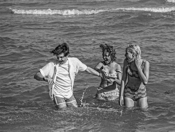 Paul McCartney in the ocean with fans in Miami, Florida, February 1964.