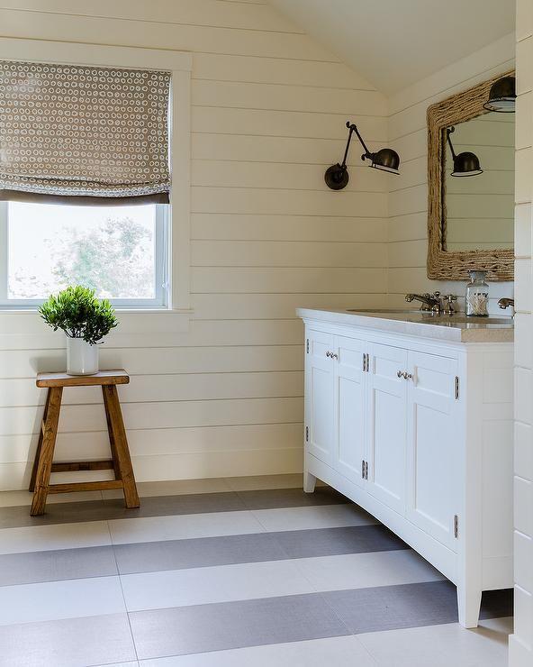 Cottage bathroom showcases a simple, modern nautical vibe ...