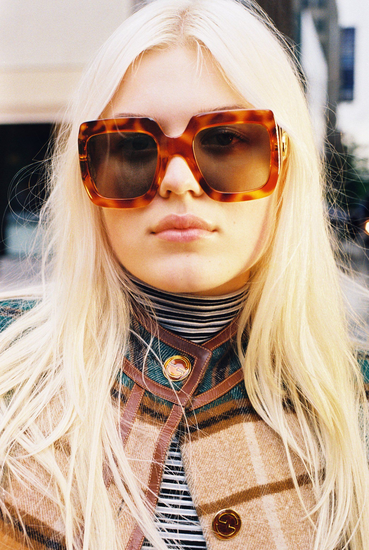 ac49520b4a42 Lulu Bonfils, 16, in a vintage tartan coat, her own striped turtleneck, and  Gucci square-frame tortoiseshell sunglasses