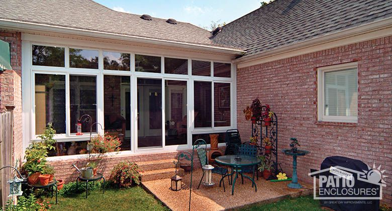 A Breezeway Enclosed With A Four Season Vinyl Sunroom In White