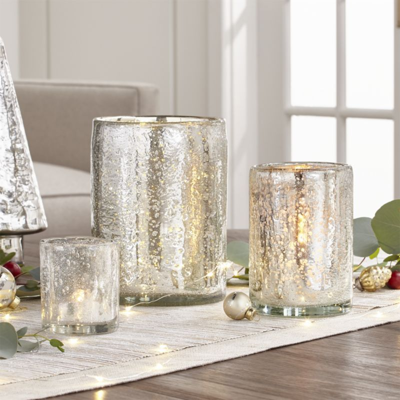 Shop Silver Hurricane Candle Holders. This handcrafted bubbled glass votive  glimmers with the silvery loo… | Candle holders, Glass hurricane candle  holder, Candles