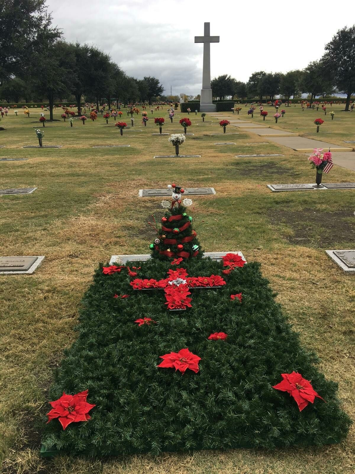Christmas Blanket left for our loved ones at their gravesite! Made from 2x4's & garland!