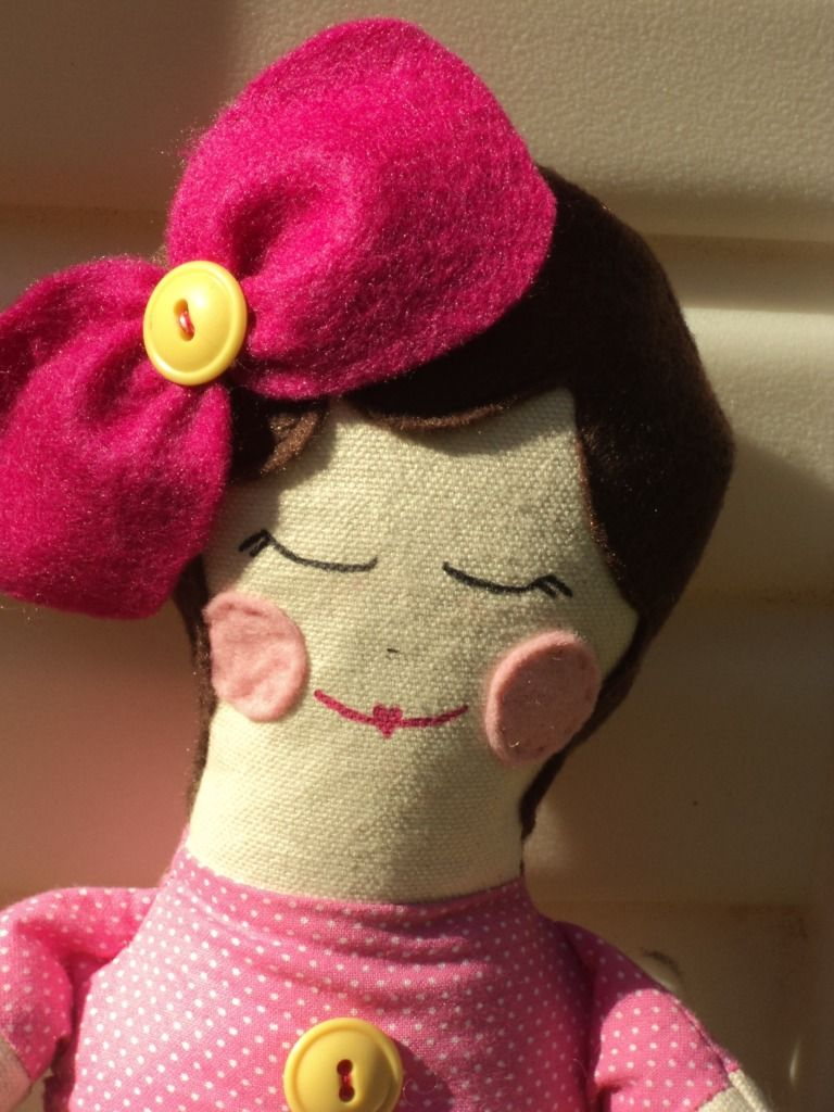 similar to a black apple doll.  really like the felt rosy cheeks rather than paint.