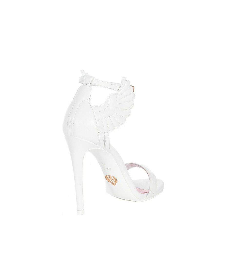 """OSCAR TIYE White sandals """"Malikah"""" in nappa leather with wings on the side leather sole front closure with adjustable strap Heel: 11 cm"""