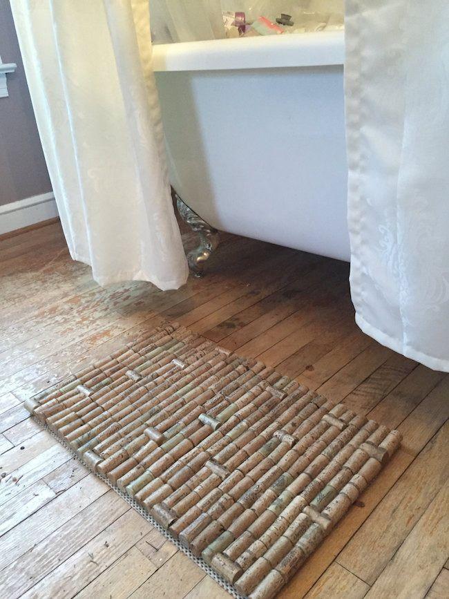 Gray Bathroom With Wood Flooring Containing Wine Cork Bath Mat