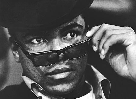 What cool looks like Muhammad Ali in black sunglasses; photo by Eddie Adams