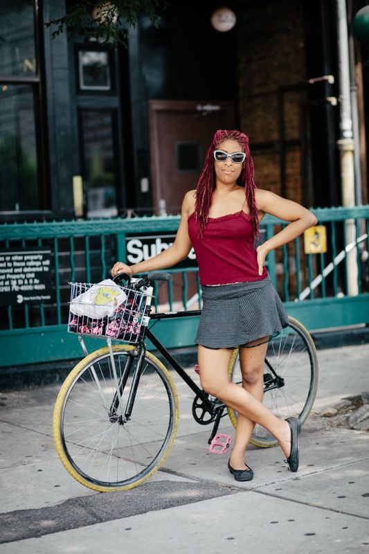 Paige rides a no-name single-speed bicycle photographed at Greene Ave. and Fulton St., Brooklyn running errands around town