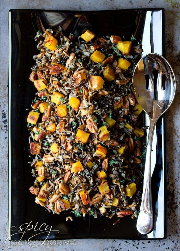Forbidden Rice with Roasted Acorn Squash Ingredients: black rice, shallots, pecan pieces, orange, fresh thyme leaves, vegetable oil, acorn squash, salt and pepper. Recipe at aspicyperspective.com
