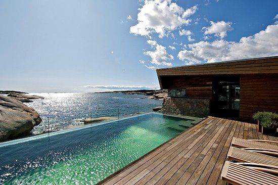 The rugged coastline of Norway is where you will find this masterful vacation home