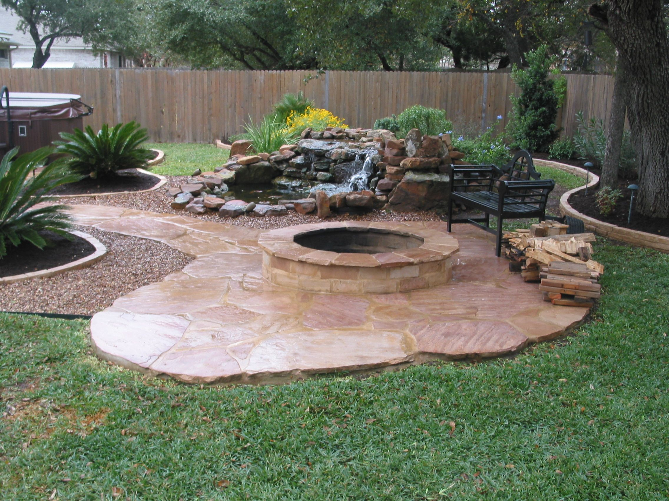 Stone fire pit designs patio traditional with artistic hardscape - Backyard Patio Ideas Patio Ideas Excellent Flagstone Patio With Fire Pit From Honed Limestone Tiles And Better Homes And Gardens Rock Fountain Also Old
